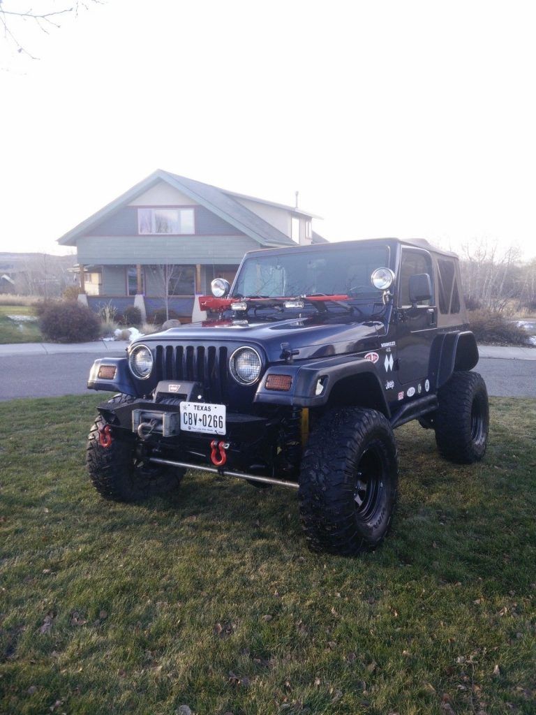 well modified 1997 Jeep Wrangler Rock Crawler monster truck