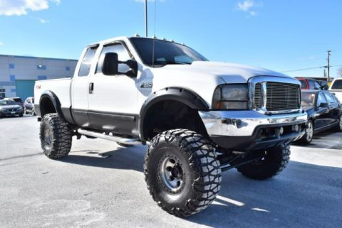 sharp 2001 Ford F 350 XLT Supercab Short Bed monster truck for sale